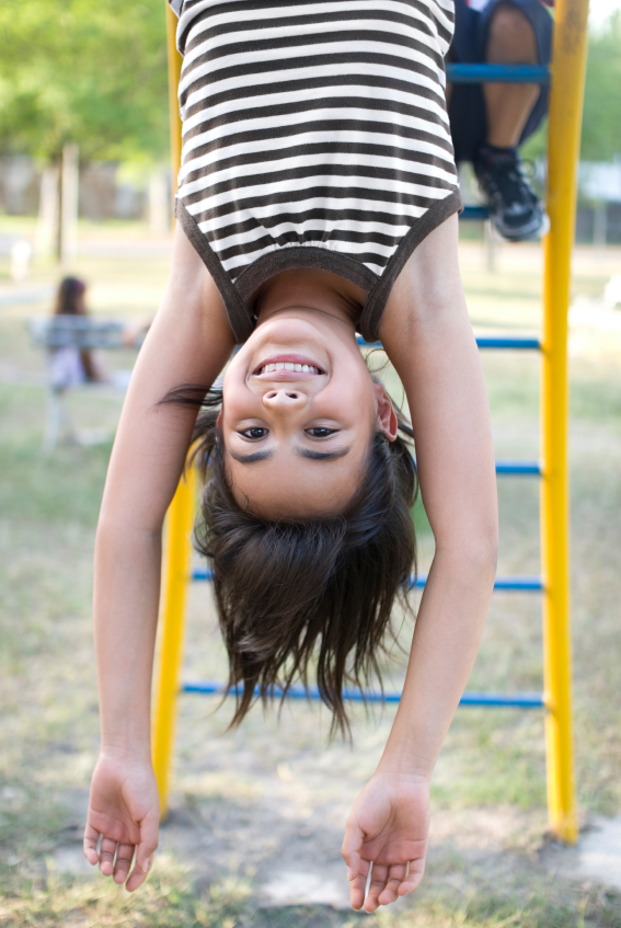 This little girl knows that the best way to treat back problems is to prevent them.  By hanging upside down from her knees she is using gravity to stretch out her back.  She obviously likes the way it feels.