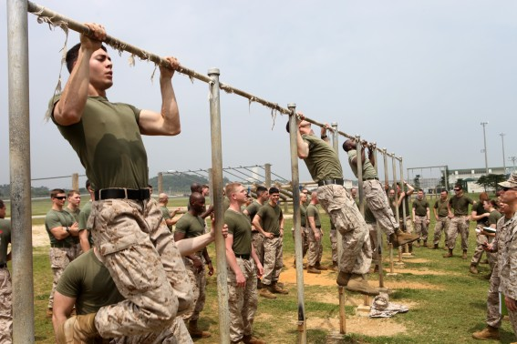 It is extremely unlikely that any of the Marines taking part in this pull up contest have any significant back problems, but if they did simply hanging from the bar would help to stretch out their back and relieve the pain.
